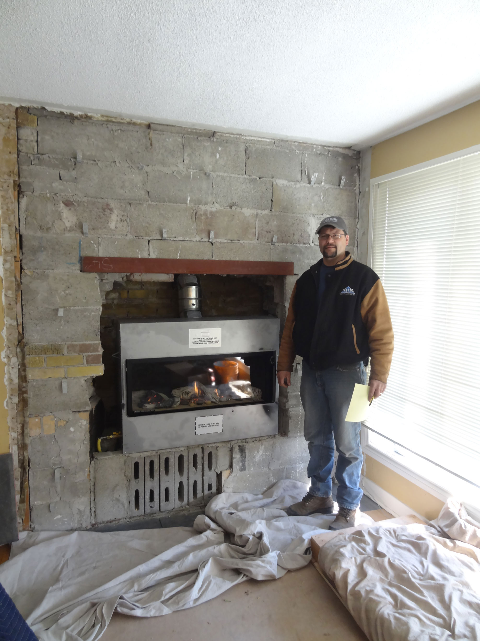 gas of tv fireplace niagara inserts above best fireplaces installation insert region with