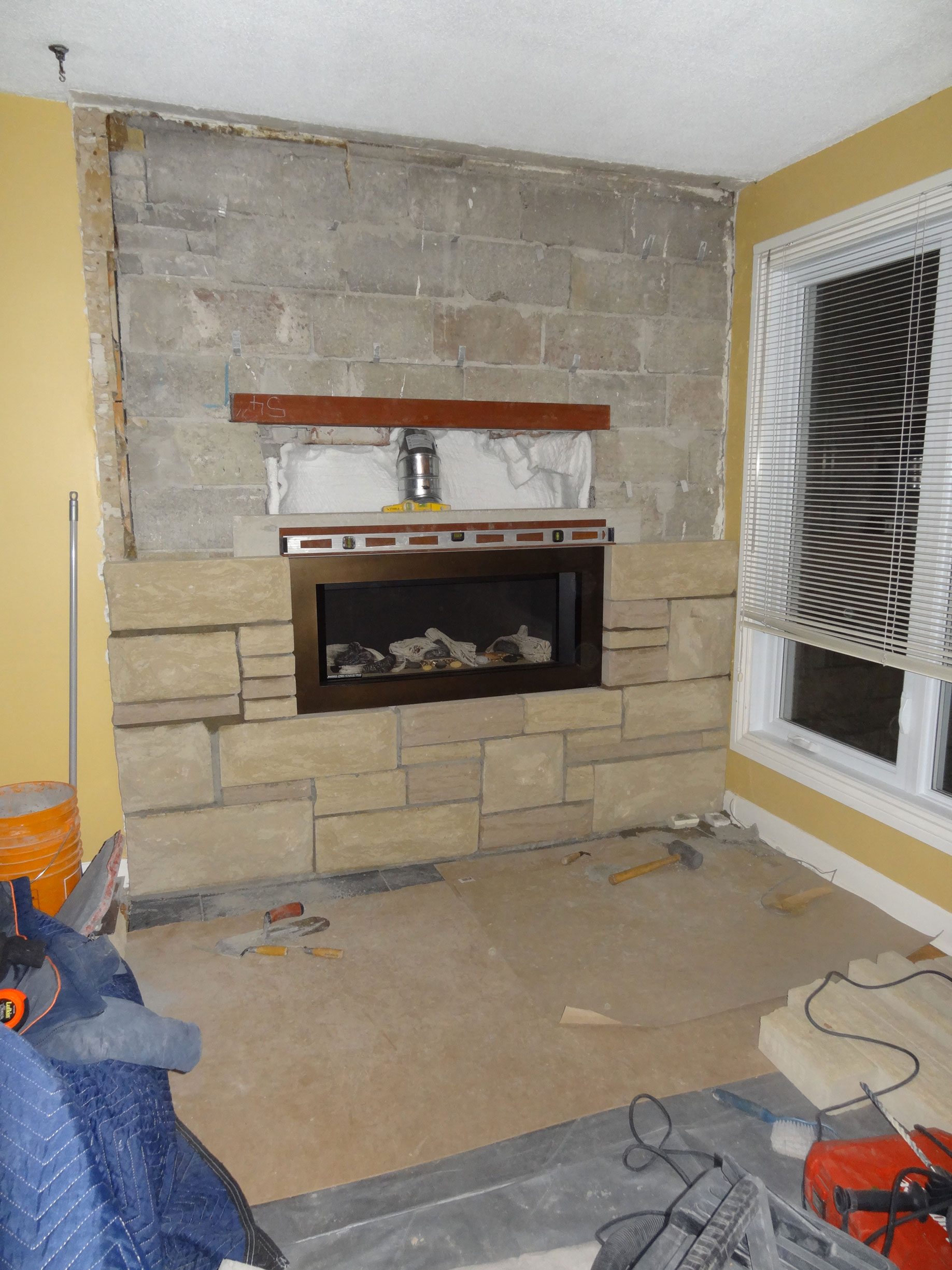stones gas pin fieplace over natural fireplace mounted stone tv