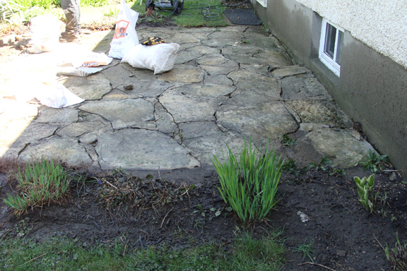 Take Apart The Existing Flagstone Patio. It Had Cement Joints, But No Cement  Slab Underneath, So Frost Heaves Had Broken All The Joints.